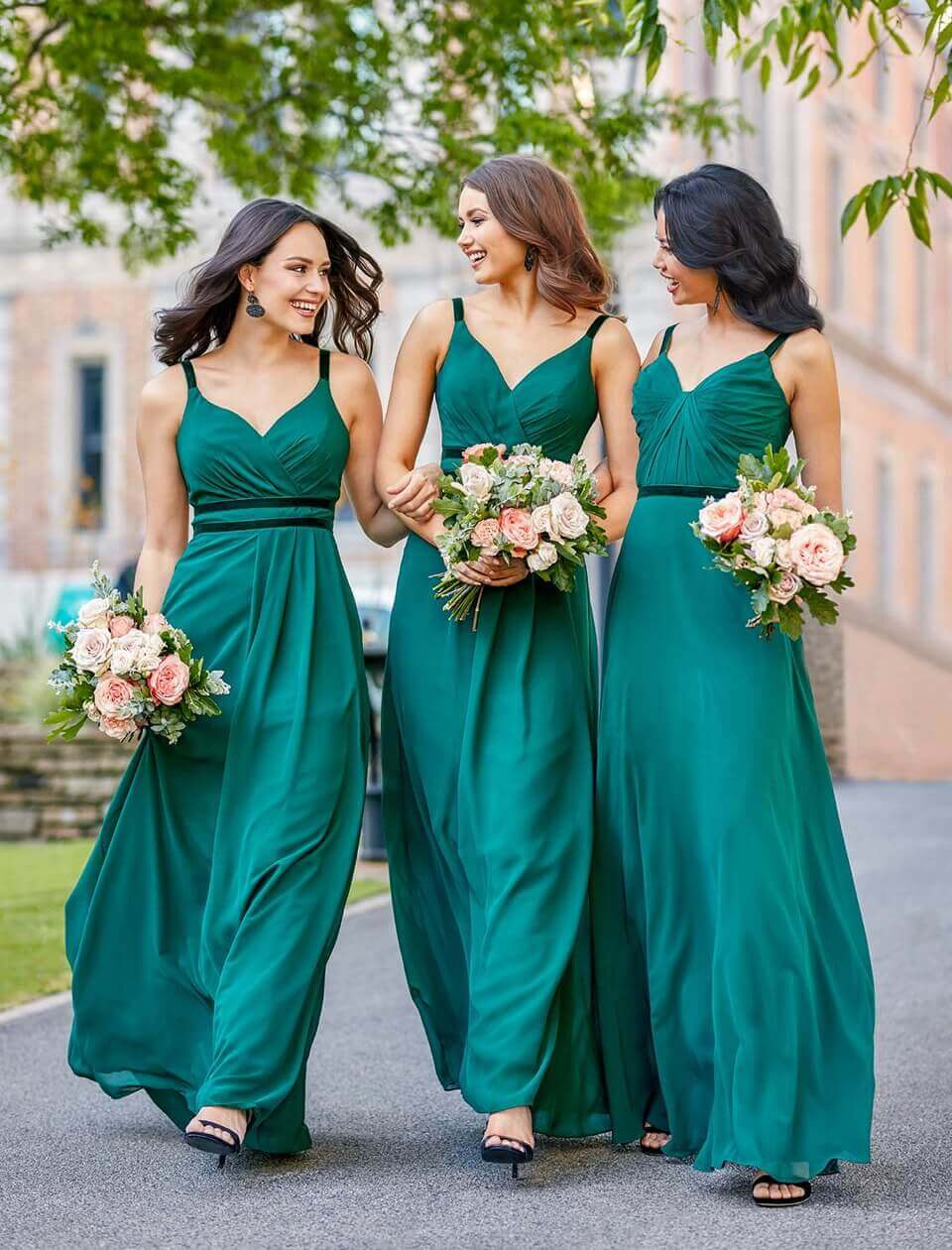 Bridesmaids wearing long green dresses