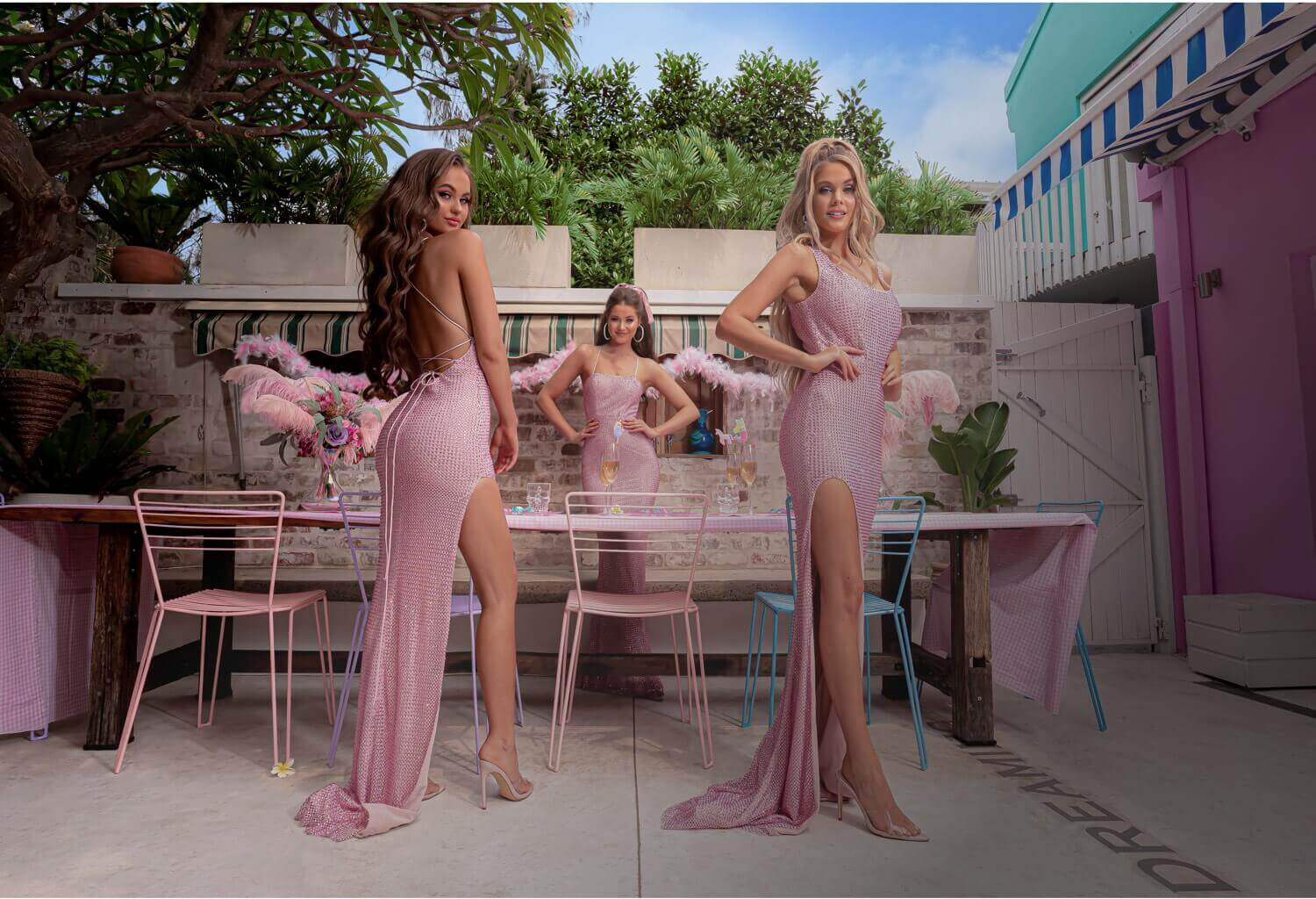 Models wearing pink prom dresses